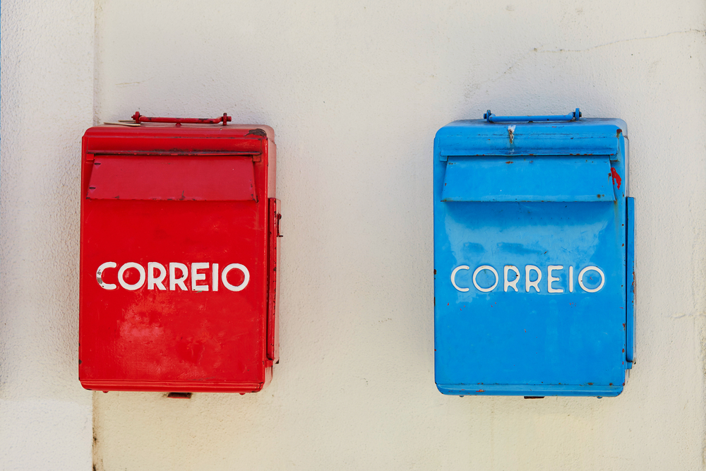 Red and blue post boxes on the wall in Lisbon, Portugal